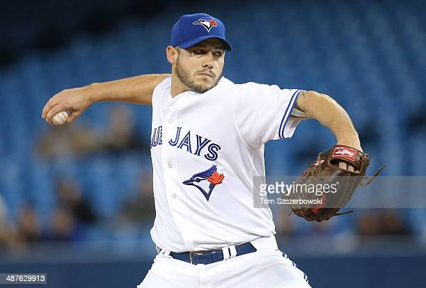 Dustin McGowan of the Toronto Blue Jays delivers a pitch during MLB game action against the Baltimore Orioles on April 23 2014 at Rogers Centre in...