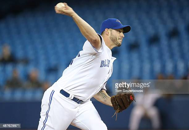 Dustin McGowan of the Toronto Blue Jays delivers a pitch in the first inning during MLB game action against the Baltimore Orioles on April 23 2014 at...