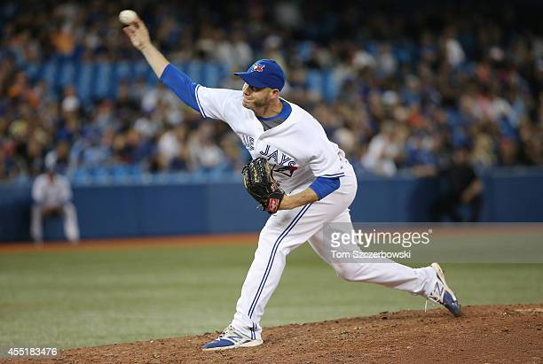 Dustin McGowan of the Toronto Blue Jays delivers a pitch in the ninth inning during MLB game action against the New York Yankees on August 29 2014 at...