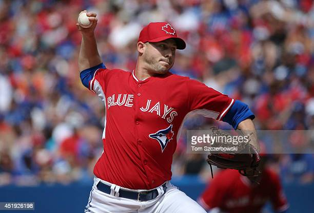 Dustin McGowan of the Toronto Blue Jays delivers a pitch in the eighth inning during MLB game action against the Milwaukee Brewers on July 1 2014 at...