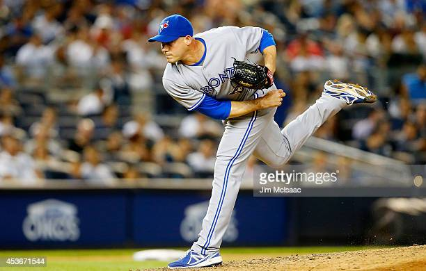 Dustin McGowan of the Toronto Blue Jays in action against the New York Yankees at Yankee Stadium on July 25 2014 in the Bronx borough of New York...