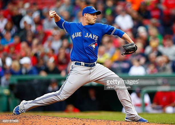 Dustin McGowan of the Toronto Blue Jays pitches against the Boston Red Sox during the game at Fenway Park on May 22 2014 in Boston Massachusetts