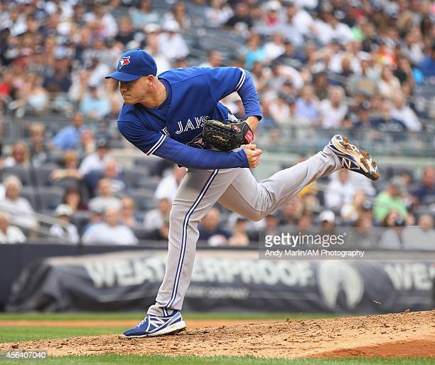 Dustin McGowan of the Toronto Blue Jays pitches against the New York Yankees at Yankee Stadium on September 21 2014 in the Bronx borough of New York...