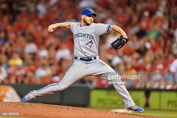Dustin McGowan of the Toronto Blue Jays pitches against the Cincinnati Reds at Great American Ball Park on June 20 2014 in Cincinnati Ohio
