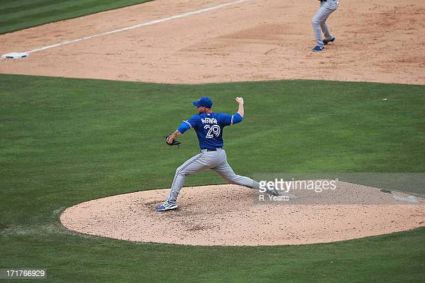 Dustin McGowan of the Toronto Blue Jays pitches against the Texas Rangers at Rangers Ballpark in Arlington on June 15 2013 in Arlington Texas