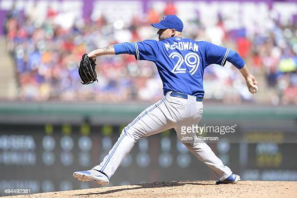 Dustin McGowan of the Toronto Blue Jays pitches against the Texas Rangers at Globe Life Park in Arlington on May 18 2014 in Arlington Texas The Texas...