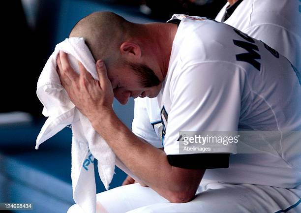 Dustin McGowan of the Toronto Blue Jays reacts after being pulled from the game in the 4th inning against the Baltimore Orioles during MLB action at...