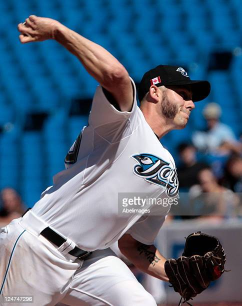 Dustin McGowan of the Toronto Blue Jays throws a pitch during MLB action against the Baltimore Orioles at the Rogers Centre September 11 2011 in...