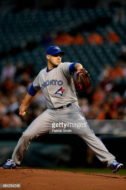 Dustin McGowan of the Toronto Blue Jays works the first inning against the Baltimore Orioles at Oriole Park at Camden Yards on April 11 2014 in...