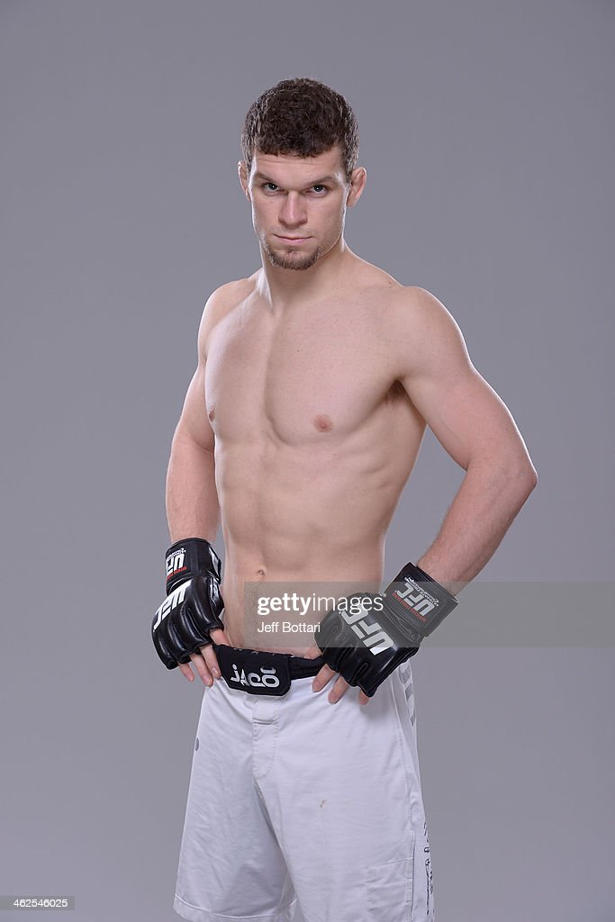 Dustin Ortiz poses for a portrait during a UFC photo session on January 12, 2014 in Duluth, Georgia.