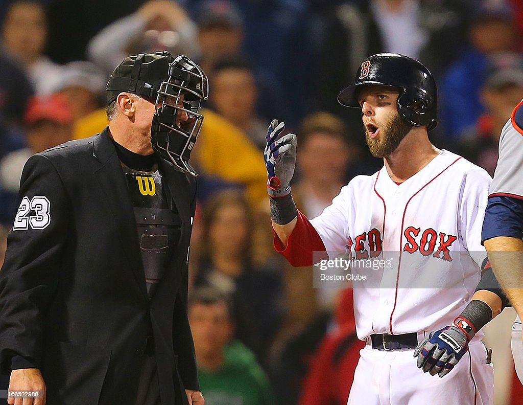 Dustin Pedroia argues a call third strike in the ninth inning with home ump Lance Barksdale. The Boston Red Sox played the Minnesota Twins at Fenway Park on May 9, 2013.