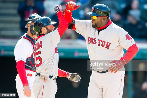 Dustin Pedroia celebrates with David Ortiz of the Boston Red Sox after both scored on a home run by Ortiz during the ninth inning of the opening day...