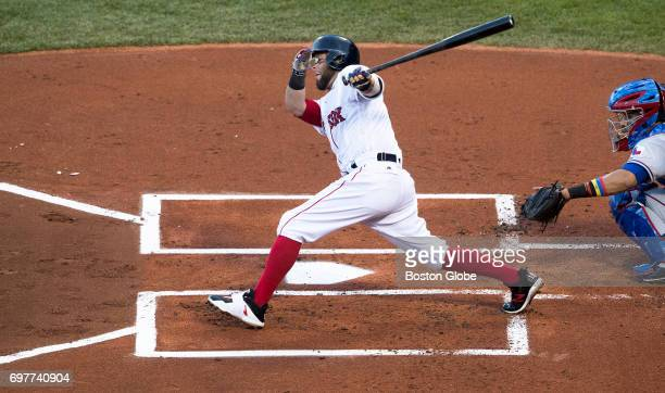 Dustin Pedroia is still legally in the batter's box on this swing because part of his foot is on the line during a game at Fenway Park in Boston on...