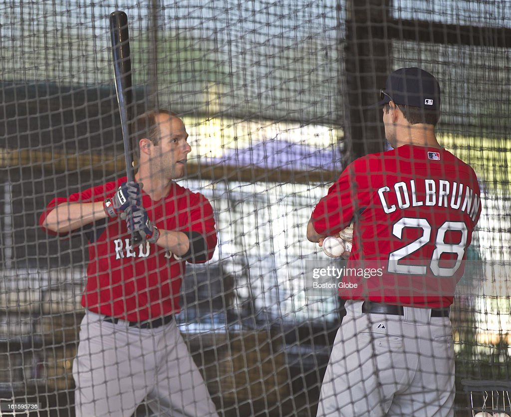 Dustin Pedroia, left, working with hitting coach, Greg Colbronn during the first official spring training day for the Boston Red Sox pitchers and catchers at JetBlue Park on Tuesday, Feb. 12, 2013.