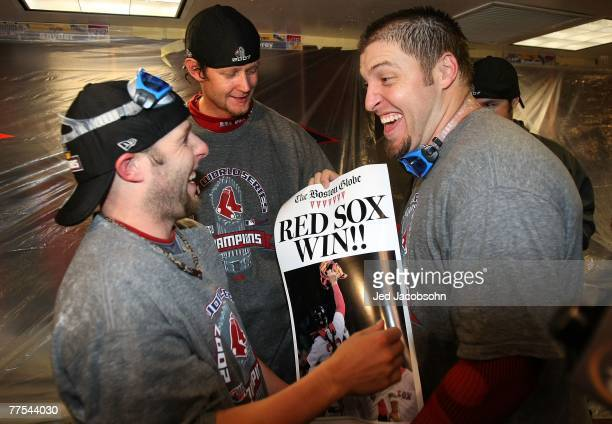Dustin Pedroia Matt Clement and Doug Mirabelli of the Boston Red Sox celebrate in the locker room after winning Game Four by a score of 43 to win the...