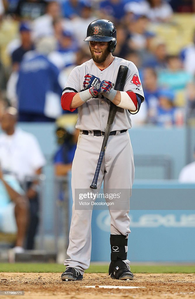 Dustin Pedroia #15 of the Boston Red Sox adjusts his gloves during his at-bat in the seventh inning against the Los Angeles Dodgers during the MLB game at Dodger Stadium on August 25, 2013 in Los Angeles, California. The Red Sox defeated the Dodgers 8-1.