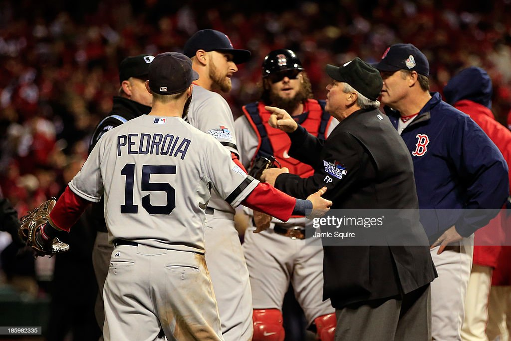 <a gi-track='captionPersonalityLinkClicked' href=/galleries/search?phrase=Dustin+Pedroia&family=editorial&specificpeople=836339 ng-click='$event.stopPropagation()'>Dustin Pedroia</a> #15 of the Boston Red Sox and others react after <a gi-track='captionPersonalityLinkClicked' href=/galleries/search?phrase=Allen+Craig&family=editorial&specificpeople=4405049 ng-click='$event.stopPropagation()'>Allen Craig</a> #21 of the St. Louis Cardinals scored the winning run in the ninth inning of Game Three of the 2013 World Series at Busch Stadium on October 26, 2013 in St Louis, Missouri.
