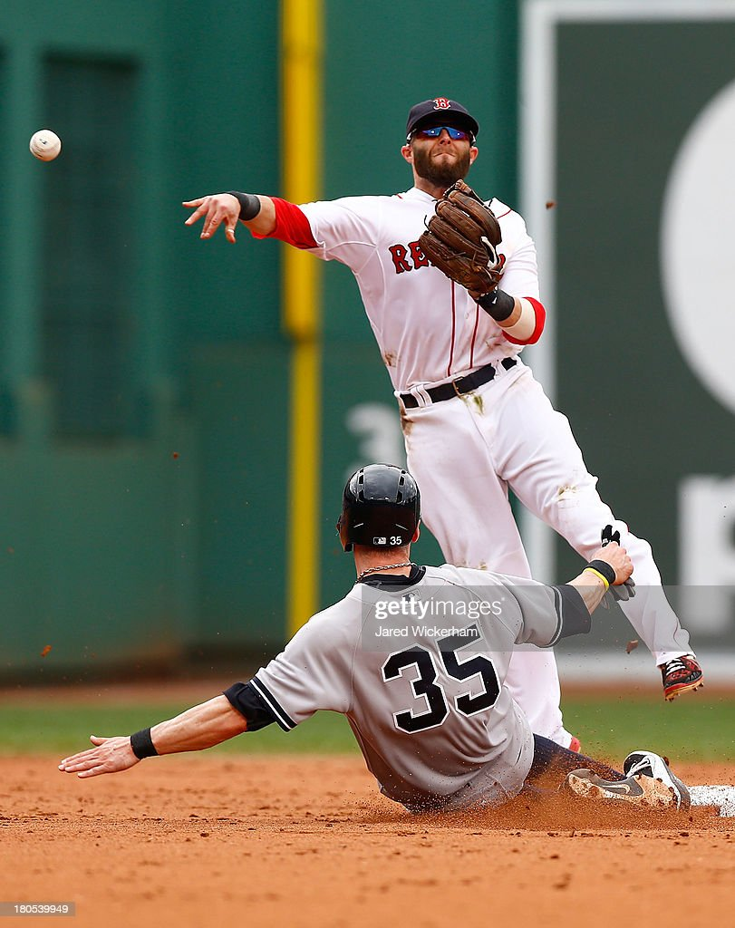 Dustin Pedroia #15 of the Boston Red Sox attempts to turn a double play over Brendan Ryan #35 of the New York Yankees in the fifth inning during the game on September 14, 2013 at Fenway Park in Boston, Massachusetts.