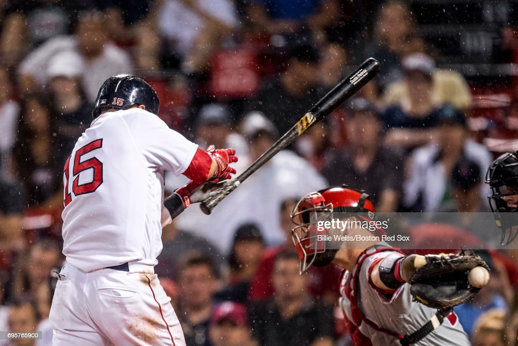 Dustin Pedroia #15 of the Boston Red Sox avoids being hit by a pitch during the eleventh inning of a game against the Philadelphia Phillies on June 13, 2017 at Fenway Park in Boston, Massachusetts.
