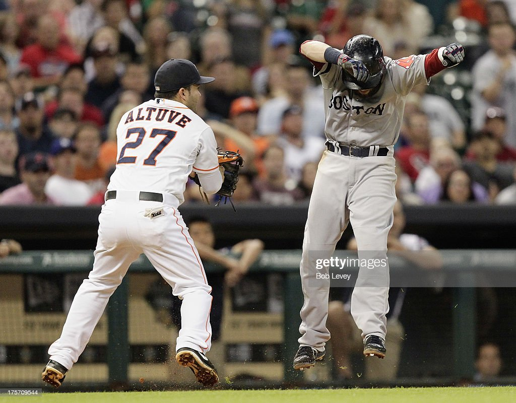 <a gi-track='captionPersonalityLinkClicked' href=/galleries/search?phrase=Dustin+Pedroia&family=editorial&specificpeople=836339 ng-click='$event.stopPropagation()'>Dustin Pedroia</a> #15 of the Boston Red Sox avoids the tag attempt by <a gi-track='captionPersonalityLinkClicked' href=/galleries/search?phrase=Jose+Altuve&family=editorial&specificpeople=7934195 ng-click='$event.stopPropagation()'>Jose Altuve</a> #27 of the Houston Astros in the sixth inning at Minute Maid Park on August 6, 2013 in Houston, Texas. Pedroia was tagged out at home plate on the play.