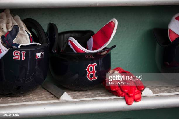 Dustin Pedroia of the Boston Red Sox batting helmet and batting gloves in the dugout during the Spring Training game against the Team USA at Jet Blu...