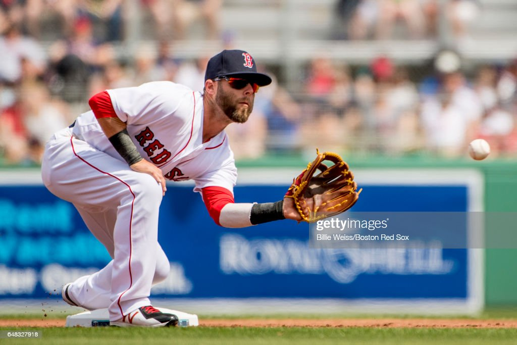 Dustin Pedroia #15 of the Boston Red Sox catches a throw during the first inning of a Spring Training game against the Atlanta Braves on March 5, 2017 at Fenway South in Fort Myers, Florida .