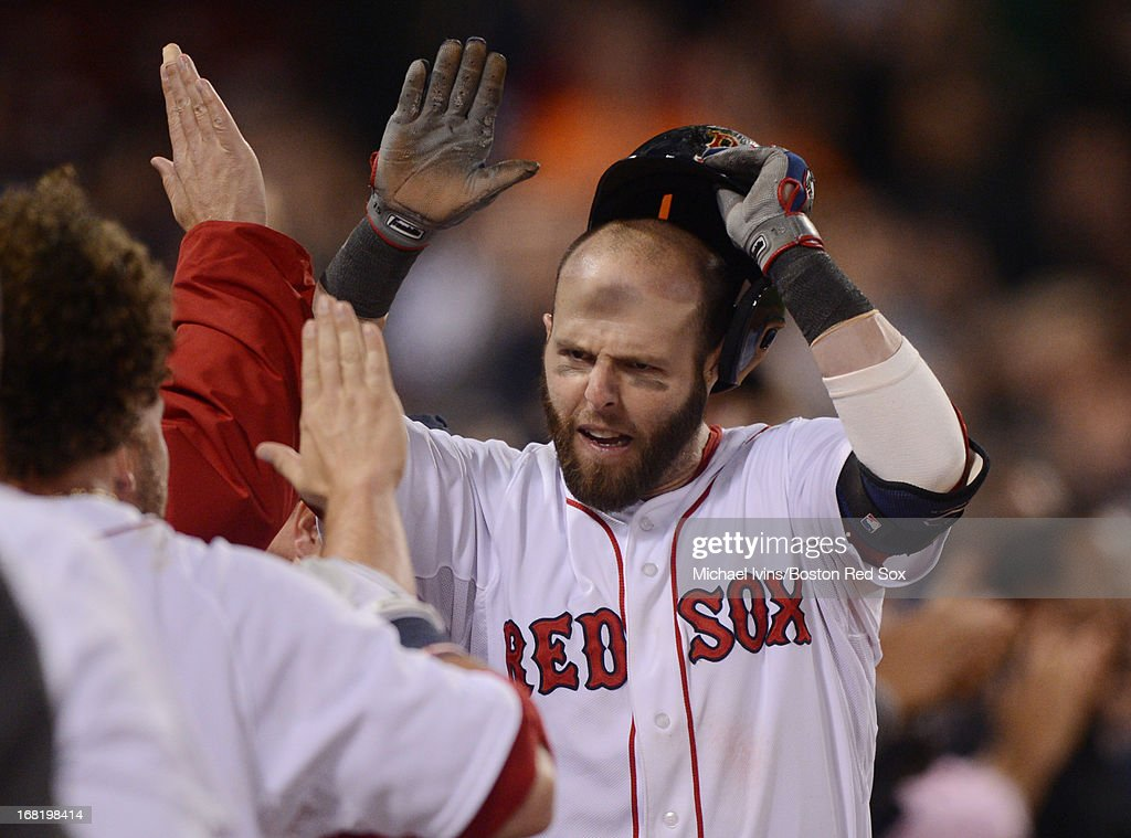 Dustin Pedroia #15 of the Boston Red Sox celebrates after hitting a home run against the Minnesota Twins in the eighth inning on May 6, 2013 at Fenway Park in Boston, Massachusetts.