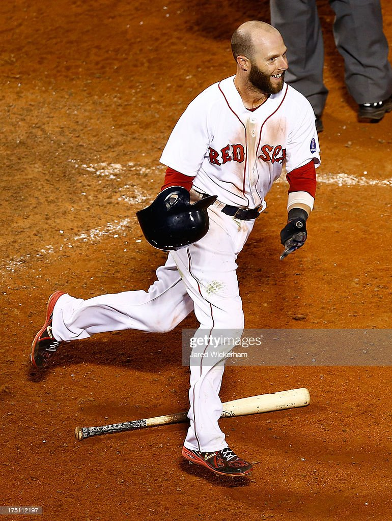 <a gi-track='captionPersonalityLinkClicked' href=/galleries/search?phrase=Dustin+Pedroia&family=editorial&specificpeople=836339 ng-click='$event.stopPropagation()'>Dustin Pedroia</a> #15 of the Boston Red Sox celebrates after teammate Stephen Drew #7 of the Boston Red Sox hit the game-winning hit to drive him in and score in the bottom of the 15th inning against the Seattle Mariners during the game on August 1, 2013 at Fenway Park in Boston, Massachusetts.