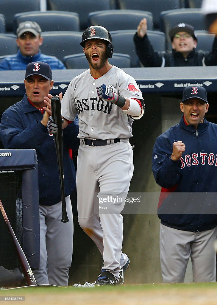 <a gi-track='captionPersonalityLinkClicked' href=/galleries/search?phrase=Dustin+Pedroia&family=editorial&specificpeople=836339 ng-click='$event.stopPropagation()'>Dustin Pedroia</a> #15 of the Boston Red Sox celebrates as both Jarrod Saltalamacchia #39 and Jonny Gomes #5 score in the ninth inning against the New York Yankees during Opening Day on April 1, 2013 at Yankee Stadium in the Bronx borough of New York City.