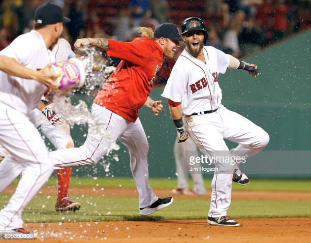Dustin Pedroia of the Boston Red Sox celebrates his gamewinning hit to give the Red Sox a 65 win in eleven innings against the Philadelphia Phillies...
