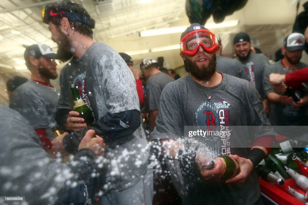 <a gi-track='captionPersonalityLinkClicked' href=/galleries/search?phrase=Dustin+Pedroia&family=editorial&specificpeople=836339 ng-click='$event.stopPropagation()'>Dustin Pedroia</a> #15 of the Boston Red Sox celebrates in the locker room after defeating the St. Louis Cardinals 6-1 in Game Six of the 2013 World Series at Fenway Park on October 30, 2013 in Boston, Massachusetts.