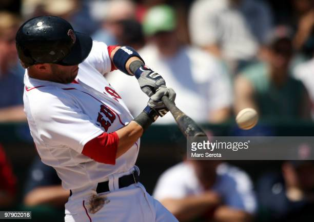Dustin Pedroia of the Boston Red Sox connects for a single against the Baltimore Orioles on March 20 2010 at City of Palms Park in Fort Myers Florida