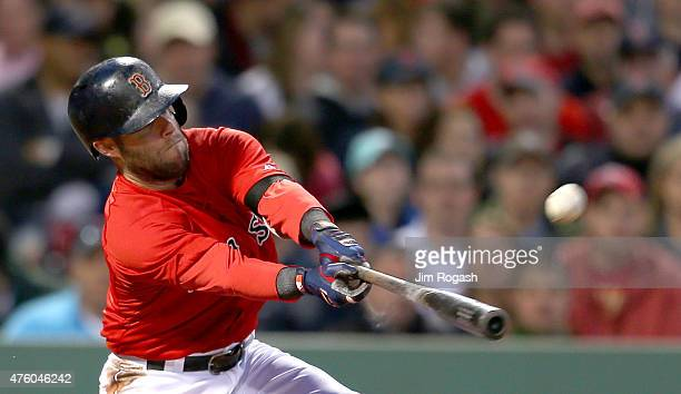 Dustin Pedroia of the Boston Red Sox doubles in the fifth inning against the Oakland Athletics at Fenway Park on June 5 2015 in Boston Massachusetts