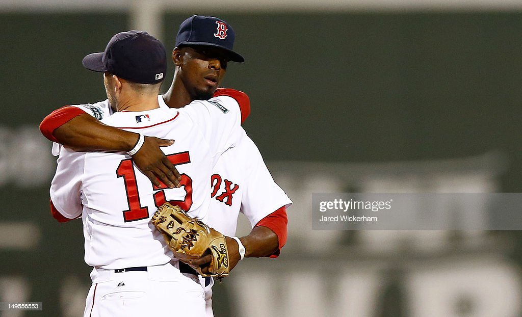<a gi-track='captionPersonalityLinkClicked' href=/galleries/search?phrase=Dustin+Pedroia&family=editorial&specificpeople=836339 ng-click='$event.stopPropagation()'>Dustin Pedroia</a> #15 of the Boston Red Sox embraces teammate Pedro Ciriaco #77 following their win against the Detroit Tigers during the game on July 30, 2012 at Fenway Park in Boston, Massachusetts.