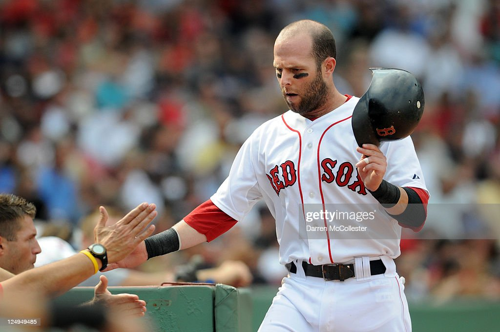 <a gi-track='captionPersonalityLinkClicked' href=/galleries/search?phrase=Dustin+Pedroia&family=editorial&specificpeople=836339 ng-click='$event.stopPropagation()'>Dustin Pedroia</a> #15 of the Boston Red Sox gets congratulated by teammates after scoring a run in the second inning against the Toronto Blue Jays at Fenway Park on September 14, 2011 in Boston, Massachusetts.