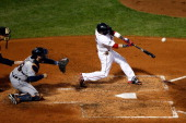 Dustin Pedroia of the Boston Red Sox hits a ball that was ruled a foul ball in the third inning against Max Scherzer of the Detroit Tigers during...