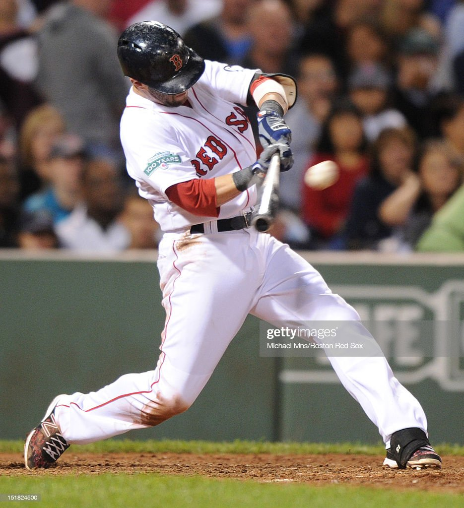 Dustin Pedroia #15 of the Boston Red Sox hits a home run against the New York Yankees in the sixth inning on September 11, 2012 at Fenway Park in Boston, Massachusetts.