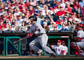 Dustin Pedroia of the Boston Red Sox hits a solo home run during the fifth inning against the Philadelphia Phillies in Philadelphia Pennsylvania on...
