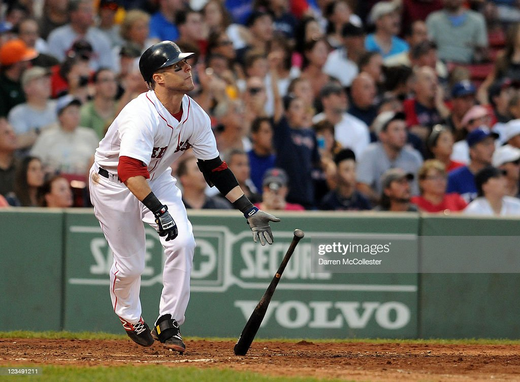 Dustin Pedroia #15 of the Boston Red Sox hits a three run double in the sixth inning against the Texas Rangers at Fenway Park on September 3, 2011 in Boston, Massachusetts.