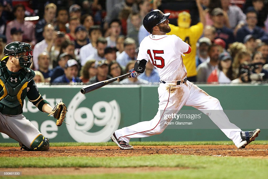 Dustin Pedroia #15 of the Boston Red Sox hits a two-run home run in the fourth inning during the game against the Oakland Athletics at Fenway Park on May 11, 2016 in Boston, Massachusetts.
