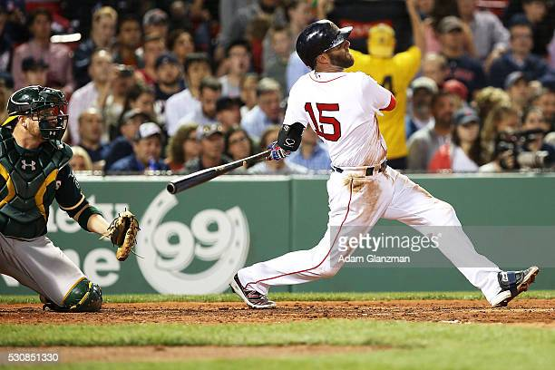 Dustin Pedroia of the Boston Red Sox hits a tworun home run in the fourth inning during the game against the Oakland Athletics at Fenway Park on May...
