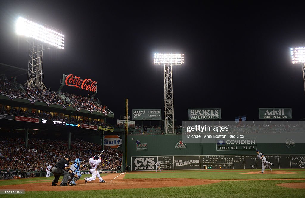 Dustin Pedroia #15 of the Boston Red Sox hits an RBI double against David Price #14 of the Tampa Bay Rays during the fifth inning of game two of the American League Division Series on October 5, 2013 at Fenway Park in Boston, Massachusetts.