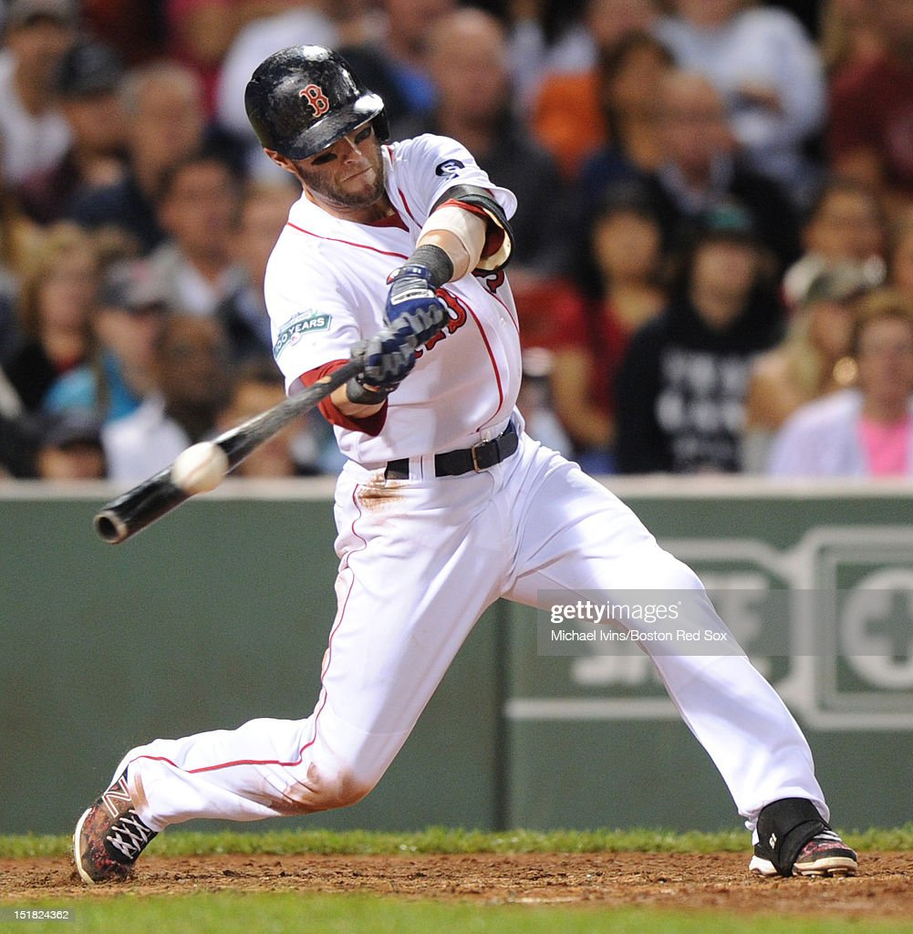 <a gi-track='captionPersonalityLinkClicked' href=/galleries/search?phrase=Dustin+Pedroia&family=editorial&specificpeople=836339 ng-click='$event.stopPropagation()'>Dustin Pedroia</a> #15 of the Boston Red Sox hits an RBI single against the New York Yankees in the third inning on September 11, 2012 at Fenway Park in Boston, Massachusetts.