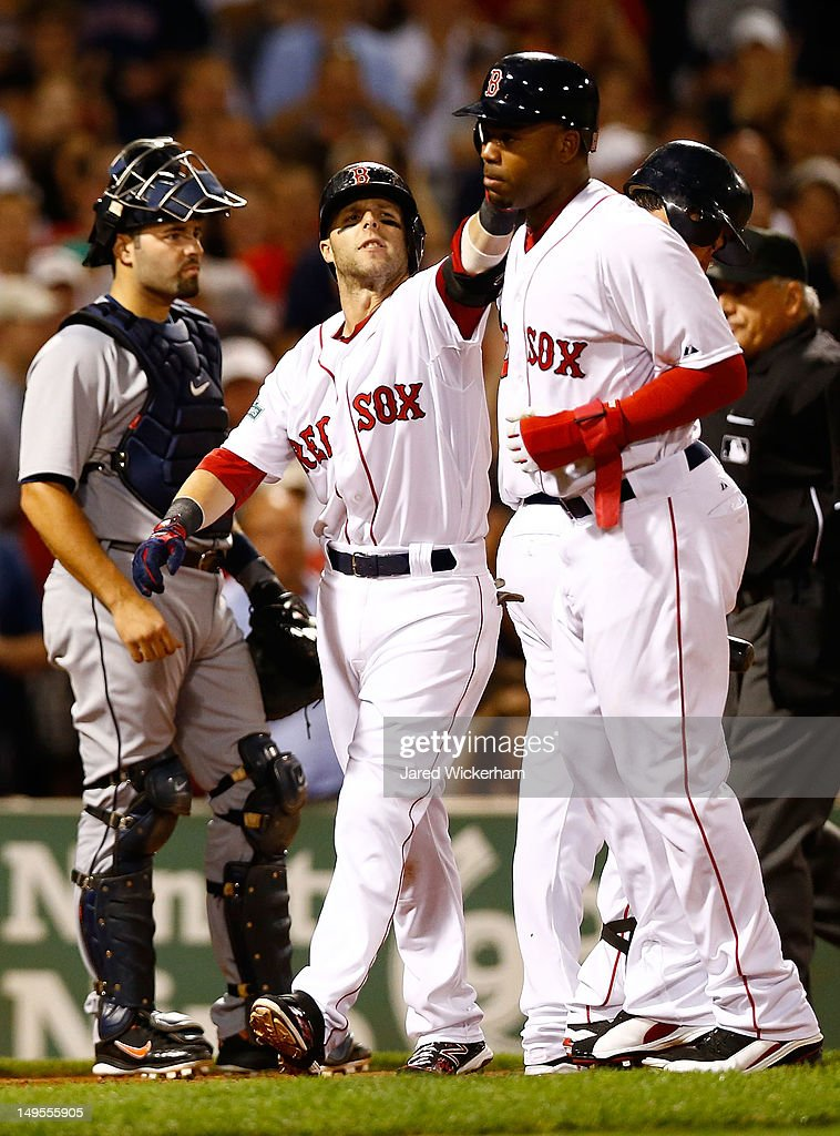 <a gi-track='captionPersonalityLinkClicked' href=/galleries/search?phrase=Dustin+Pedroia&family=editorial&specificpeople=836339 ng-click='$event.stopPropagation()'>Dustin Pedroia</a> #15 of the Boston Red Sox is congratulated by teammate <a gi-track='captionPersonalityLinkClicked' href=/galleries/search?phrase=Carl+Crawford&family=editorial&specificpeople=208074 ng-click='$event.stopPropagation()'>Carl Crawford</a> #13 after hitting a two run home run against the Detroit Tigers in the sixth inning during the game on July 30, 2012 at Fenway Park in Boston, Massachusetts. (Photo by Jared Wickerham/Getty Images) <a gi-track='captionPersonalityLinkClicked' href=/galleries/search?phrase=Carl+Crawford&family=editorial&specificpeople=208074 ng-click='$event.stopPropagation()'>Carl Crawford</a>; Adrian Gonzalez