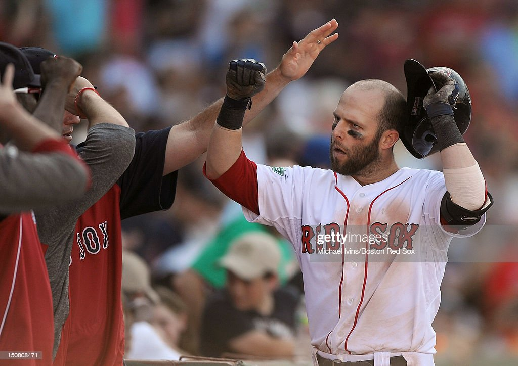 <a gi-track='captionPersonalityLinkClicked' href=/galleries/search?phrase=Dustin+Pedroia&family=editorial&specificpeople=836339 ng-click='$event.stopPropagation()'>Dustin Pedroia</a> #15 of the Boston Red Sox is congratulated by teammates at the dugout after hitting a home run against the Kansas City Royals in the eighth inning on August 26, 2012 at Fenway Park in Boston, Massachusetts.