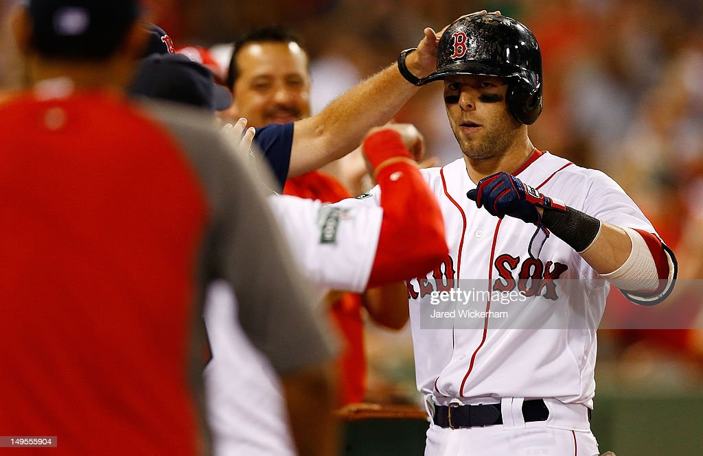 <a gi-track='captionPersonalityLinkClicked' href=/galleries/search?phrase=Dustin+Pedroia&family=editorial&specificpeople=836339 ng-click='$event.stopPropagation()'>Dustin Pedroia</a> #15 of the Boston Red Sox is congratulated by teammates in the dugout after hitting a two run home run against the Detroit Tigers in the sixth inning during the game on July 30, 2012 at Fenway Park in Boston, Massachusetts. (Photo by Jared Wickerham/Getty Images) Carl Crawford; Adrian Gonzalez