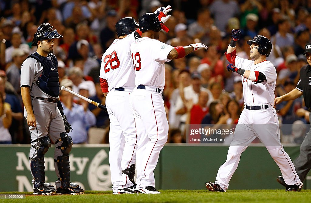 <a gi-track='captionPersonalityLinkClicked' href=/galleries/search?phrase=Dustin+Pedroia&family=editorial&specificpeople=836339 ng-click='$event.stopPropagation()'>Dustin Pedroia</a> #15 of the Boston Red Sox is congratulated by teammates <a gi-track='captionPersonalityLinkClicked' href=/galleries/search?phrase=Carl+Crawford&family=editorial&specificpeople=208074 ng-click='$event.stopPropagation()'>Carl Crawford</a> #13 and Adrian Gonzalez #28 after hitting a two run home run against the Detroit Tigers in the sixth inning during the game on July 30, 2012 at Fenway Park in Boston, Massachusetts. (Photo by Jared Wickerham/Getty Images) <a gi-track='captionPersonalityLinkClicked' href=/galleries/search?phrase=Carl+Crawford&family=editorial&specificpeople=208074 ng-click='$event.stopPropagation()'>Carl Crawford</a>; Adrian Gonzalez