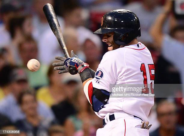 Dustin Pedroia of the Boston Red Sox is hit by a pitch thrown by Roberto Hernandez of the Tampa Bay Rays in the third inning on July 23 2013 at...