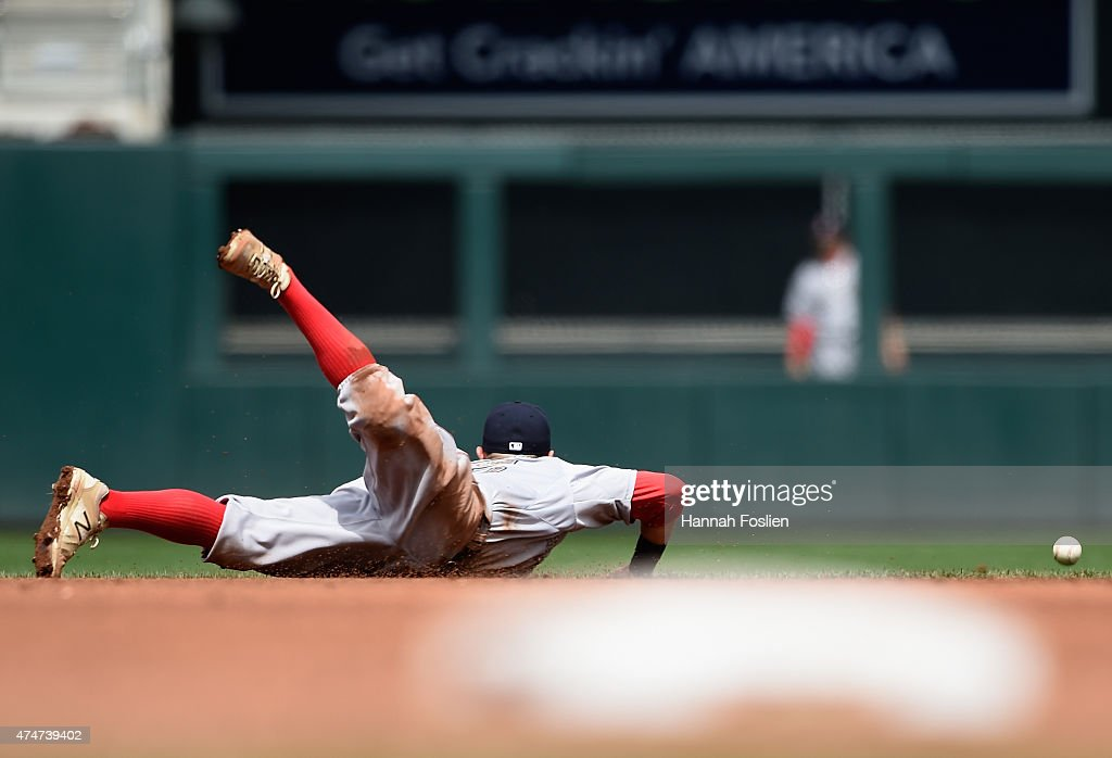 Dustin Pedroia #15 of the Boston Red Sox is unable to come up with a ball off the bat of Kurt Suzuki of the Minnesota Twins during the sixth inning of the game on May 25, 2015 at Target Field in Minneapolis, Minnesota. The Twins defeated the Red Sox 7-2.