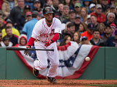 Dustin Pedroia of the Boston Red Sox lays down a sacrifice bunt during the third inning against the Baltimore Orioles at Fenway Park in Boston...